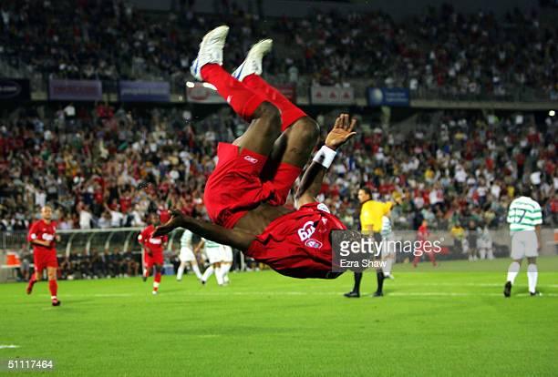 Djibril Cisse of Liverpool does a flip after scoring a goal in the second half against Celtic July 26 2004 at Rentschler Field in East Hartford...