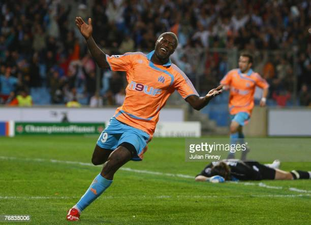 Djibril Cisse of Marseille celebrates scoring his team's second goal during the UEFA Champions League Group A match between Marseille and Besiktas at...