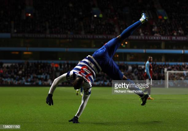 Djibril Cisse of QPR celebrates scoring the opening goal during the Barclays Premier League match between Aston Villa and Queens Park Rangers at...