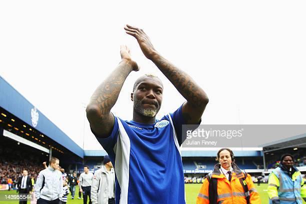 Djibril Cisse of Queens Park Rangers applauds his sides fans following the Barclays Premier League match between Queens Park Rangers and Stoke City...