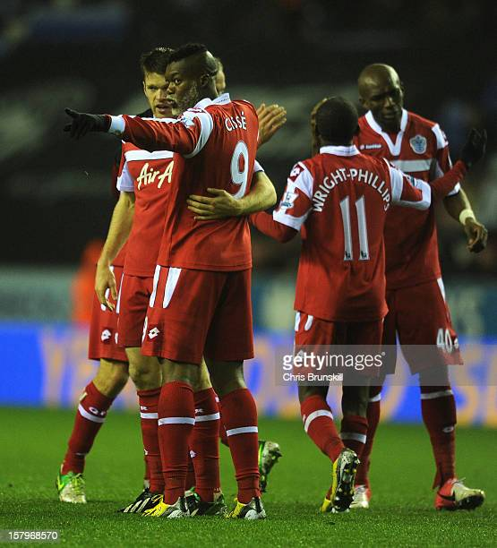 Djibril Cisse of Queens Park Rangers celebrates scoring his team's second goal with his teammates during the Barclays Premier League match between...
