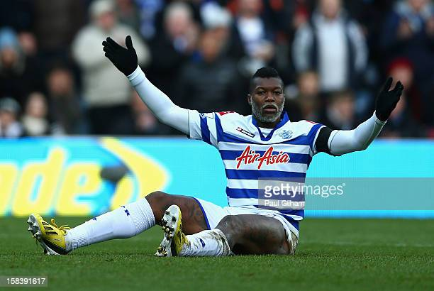 Djibril Cisse of Queens Park Rangers looks dejected during the Barclays Premier League match between Queens Park Rangers and Fulham at Loftus Road on...