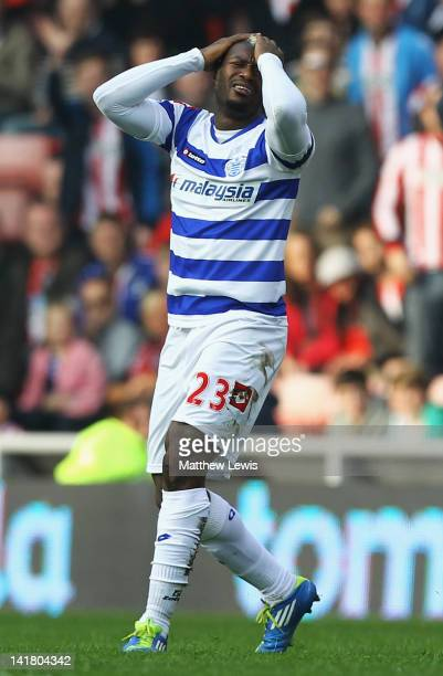Djibril Cisse of Queens Park Rangers looks on after he is sent off from the challenge on Fraizer Campbell of Sunderland during the Barclays Premier...