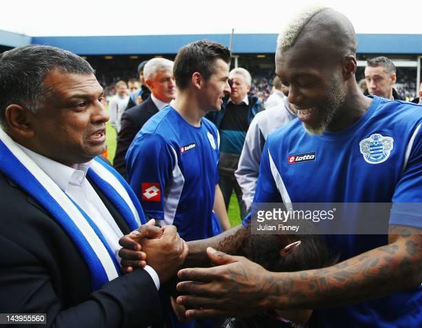 Djibril Cisse of Queens Park Rangers shakes hands with Queens Park Rangers Chairman Tony Fernandes following the Barclays Premier League match...