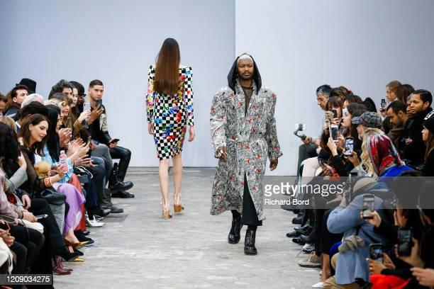 Djibril Cisse walks the runway during the Alianna Liu show as at Garage Lubeck part of the Paris Fashion Week Womenswear Fall/Winter 2020/2021 on...