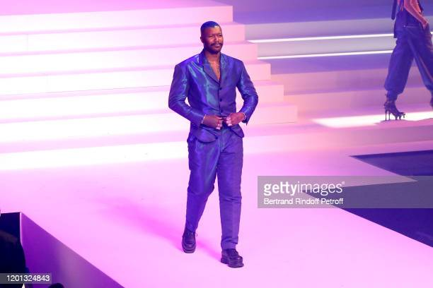 Djibril Cisse walks the runway during the JeanPaul Gaultier Haute Couture Spring/Summer 2020 show as part of Paris Fashion Week at Theatre Du...