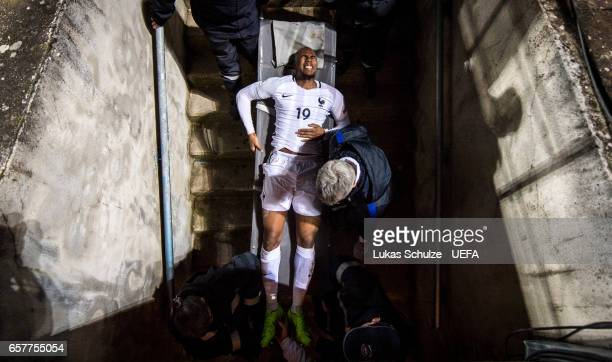 Djibril Sidi of France gets medical attention during the FIFA 2018 World Cup Qualifier between Luxembourg and France at Stade Josy Barthel on March...