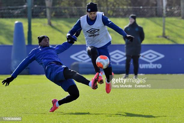 Djibril Sidibe and Dominic Calvert-Lewin challenge for the ball during the Everton training session at USM Finch Farm on February 26 2020 in...
