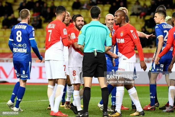 Djibril Sidibe and Joao Moutinho of Monaco with the referee Frank Schneider during the Ligue 1 match between AS Monaco and Troyes Estac at Stade...
