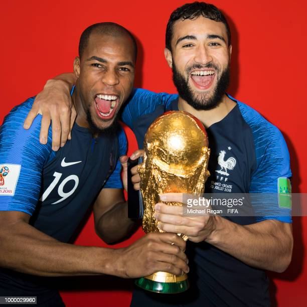 Djibril Sidibe and Nabil Fekir of France pose with the Champions World Cup trophy after the 2018 FIFA World Cup Russia Final between France and...