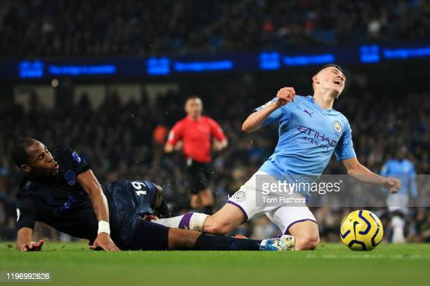 Djibril Sidibe of Everton collides with Phil Foden of Manchester City during the Premier League match between Manchester City and Everton FC at...