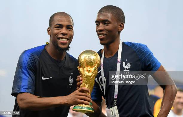 Djibril Sidibe of France celebrates victory with the World Cup trophy during the 2018 FIFA World Cup Final between France and Croatia at Luzhniki...