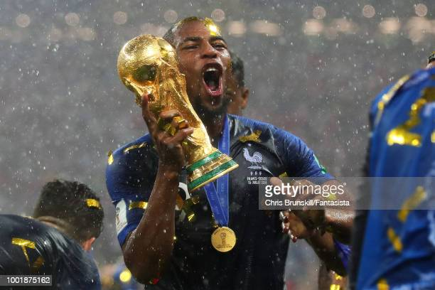Djibril Sidibe of France celebrates with the World Cup following the 2018 FIFA World Cup Russia Final between France and Croatia at Luzhniki Stadium...