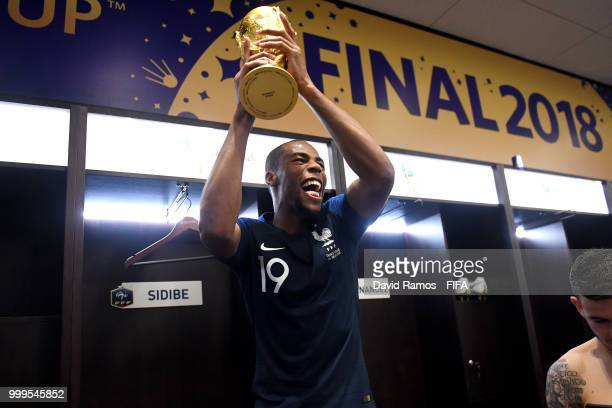 Djibril Sidibe of France celebrates with the World Cup Trophy in the dressing room following his sides victory in the 2018 FIFA World Cup Final...