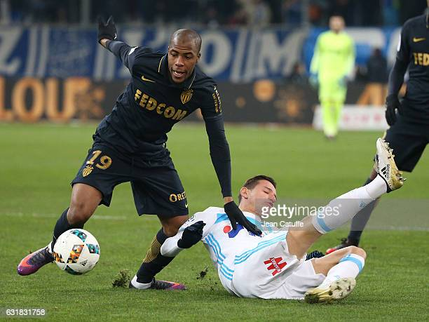 Djibril Sidibe of Monaco and Florian Thauvin of OM in action during the French Ligue 1 match between Olympique de Marseille and AS Monaco at Stade...