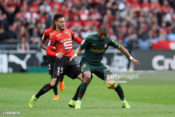 Djibril Sidibe of Monaco and Ramy BENSEBAINI of Rennes during the Ligue 1 match between Rennes and Monaco on May 1 2019 in Rennes France