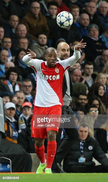 Djibril Sidibe of Monaco in action while coach of Manchester City Pep Guardiola looks on during the UEFA Champions League Round of 16 first leg match...
