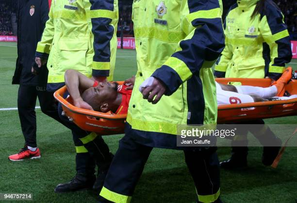 Djibril Sidibe of Monaco injured leaves the pitch on a stretcher during the Ligue 1 match between Paris Saint Germain and AS Monaco at Parc des...