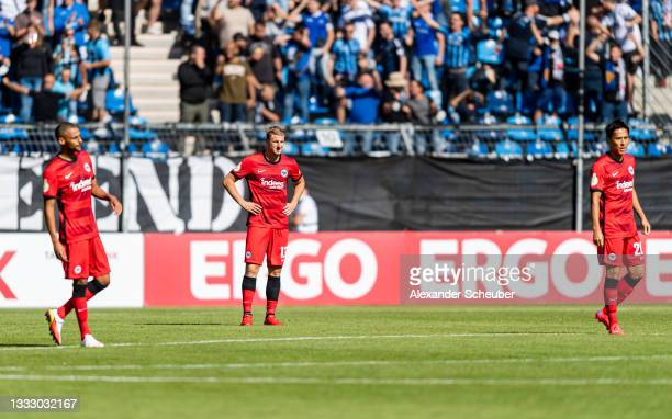 Djibril Sow, Martin Hinteregger and Makoto Hasebe of Frankfurt are disappointed during the DFB Cup first round match between Waldhof Mannheim and...