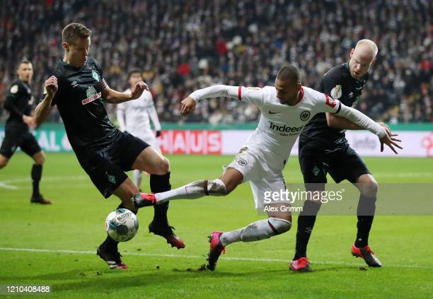 Djibril Sow of Eintracht Frankfurt controls the ball under pressure from Niklas Moisander and Davy Klaassen of SV Werder Bremen during the DFB Cup...