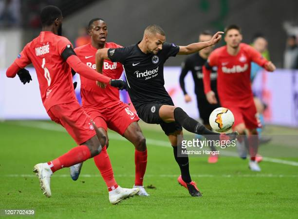 Djibril Sow of Frankfurt is challenged by Jerome Onguene of Salzburg during the UEFA Europa League round of 32 first leg match between Eintracht...