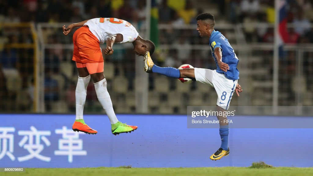 Djibrilla Ibrahim of Niger and Marcos Antonio of Brazil jumps for a