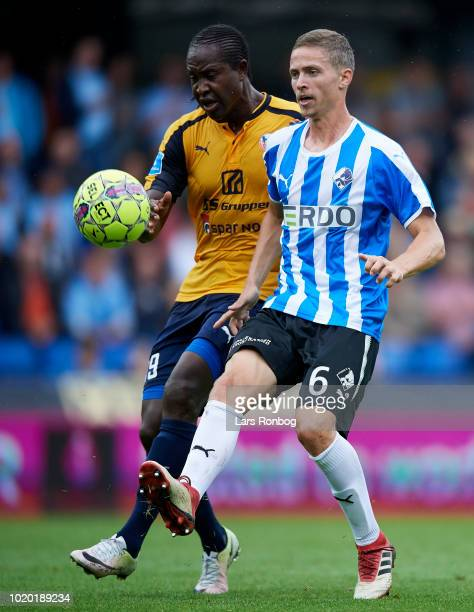 Djiby Fall of Hobro IK and Andre Romer of Randers FC compete for the ball during the Danish Superliga match between Randers FC and Hobro IK at...