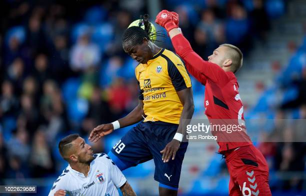 Djiby Fall of Hobro IK and Goalkeeper Aleksandar Jovanovic of AGF Aarhus compete for the ball during the Danish Superliga match between Hobro IK and...