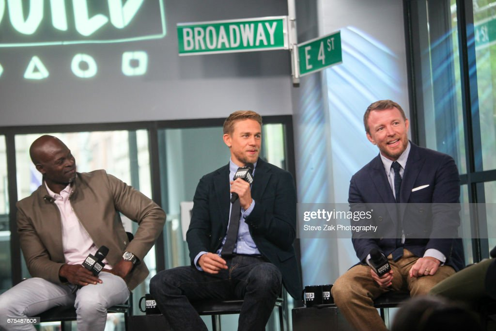 Djimon Hounsou, Charlie Hunnam and Guy Ritchie attend Build Series to discuss this new movie 'King Arthur: Legend Of The Sword' at Build Studio on May 1, 2017 in New York City.