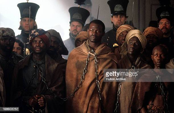 Djimon Hounsou in shackles in scene from the film 'Amistad' 1997