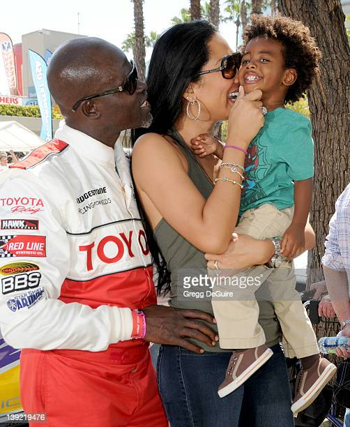 Djimon Hounsou Kimora Lee and son Kenzo pose at the 2011 Toyota Pro/Celebrity Race Race Day on the streets of Long Beach on April 16 2011 in Long...