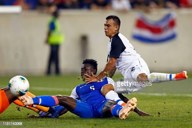 Djimy Bend Alexis of Haiti and Randall Leal of Costa Rica battle for the ball during the second half of a CONCACAF Gold Cup soccer match at Red Bull...