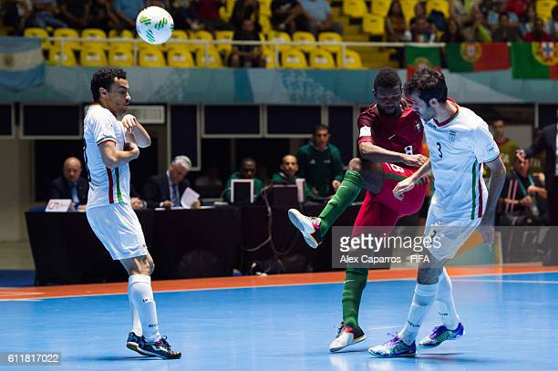 Djo of Portugal shoots the ball between Ali Hassan Zadeh and Ahmad Esmaeilpour of Iran during the FIFA Futsal World Cup Third Place Play off match...