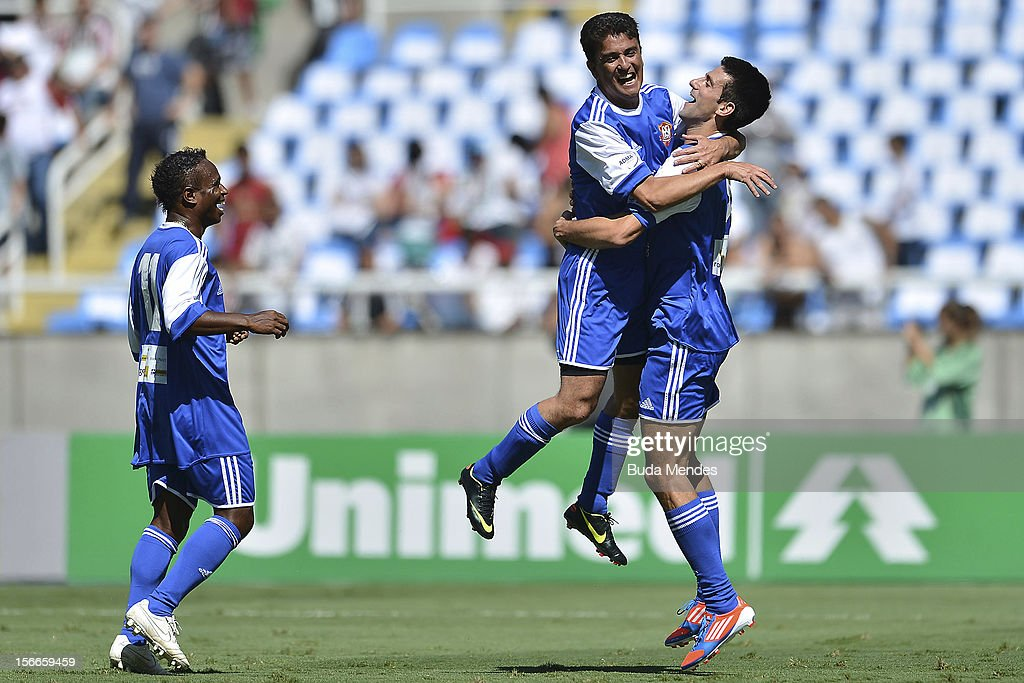 Djokovic (R) and former player Bebeto celebrate a goal during the Jogo das Estrelas Charity Soccer Match between Friends of former player Petkovic and Friends of former Brazilian player Zico at Engenhao Stadium on November 18, 2012 in Rio de Janeiro, Brazil.