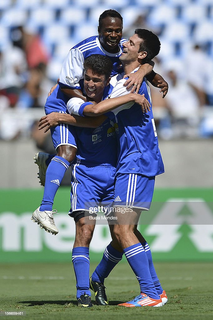 Djokovic (R), former player Bebeto and Edilson celebrate a goal during the Jogo das Estrelas Charity Soccer Match between Friends of former player Petkovic and Friends of former Brazilian player Zico at Engenhao Stadium on November 18, 2012 in Rio de Janeiro, Brazil.