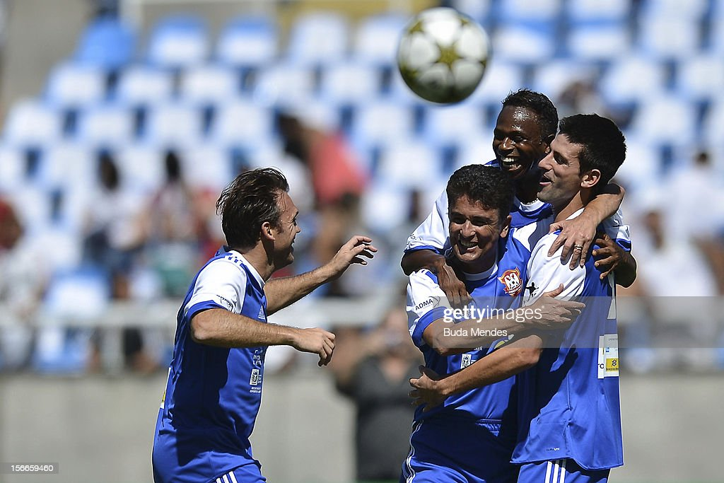 Djokovic (R), former player Bebeto, Edilson and Petkovic celebrate a goal during the Jogo das Estrelas Charity Soccer Match between Friends of former player Petkovic and Friends of former Brazilian player Zico at Engenhao Stadium on November 18, 2012 in Rio de Janeiro, Brazil.