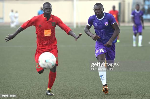 Djoliba AC Malian club's player Boubacar Traore vies with Mountain of Fire and Miracles Ministries football club Joshua Abah during the CAF...