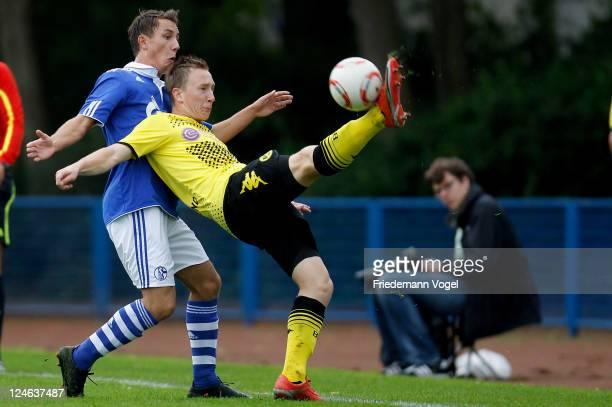 Djordje Babic of Schalke and Julius Hölscher of Dortmund battle for the ball during the A-Junioren match between FC Schalke 04 and Borussia Dortmund...