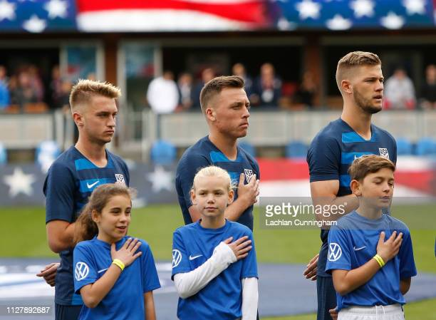Djordje Mihailovic Corey Baird and Walker Zimmerman of the United States stand for the national anthem before their international friendly match...