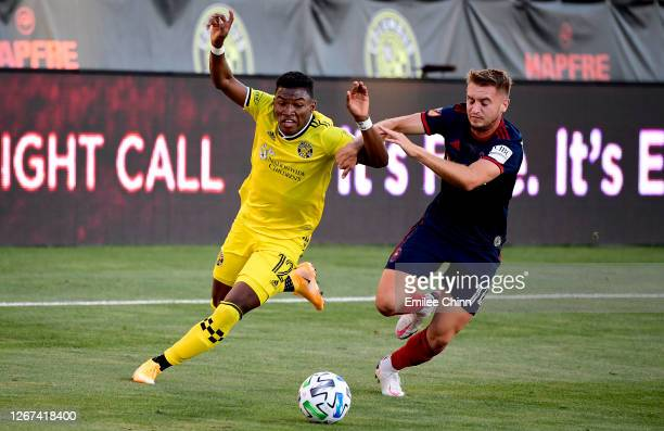Djordje Mihailovic of Chicago Fire and Luis Diaz of Columbus Crew battle for the ball in the first half during their game at MAPFRE Stadium on August...