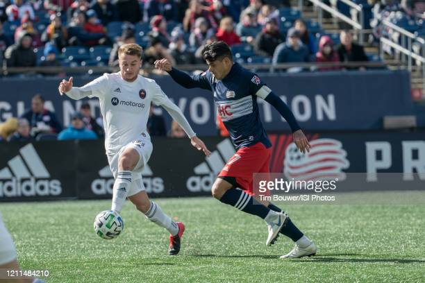 Djordje Mihailovic of Chicago Fire breaks away from Gustavo Bou of New England Revolution during a game between Chicago Fire and New England...