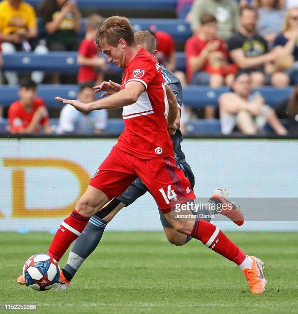 Djordje Mihailovic of Chicago Fire holds off Alexander Ring of New York City at SeatGeek Stadium on May 25 2019 in Bridgeview Illinois The Fire and...