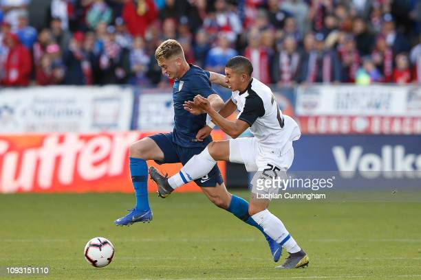 Djordje Mihailovic of the United States is tackled by Marvin Loria of Costa Rica during their international friendly match at Avaya Stadium on...