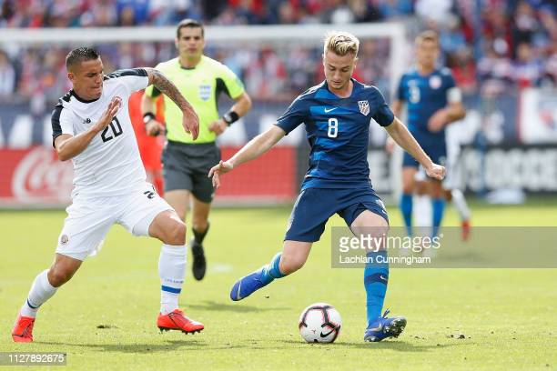 Djordje Mihailovic of the United States passes the against David Guzman of Costa Rica during their international friendly match at Avaya Stadium on...