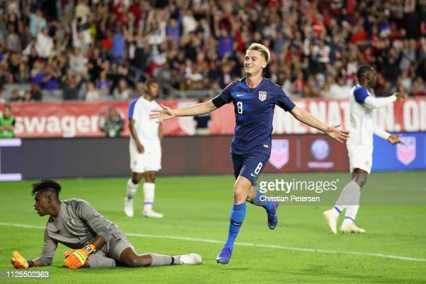 Djordje Mihailovic of United States celebrates scoring a goal past goalkeeper Eddie Roberts of Panama during the first half of the international...