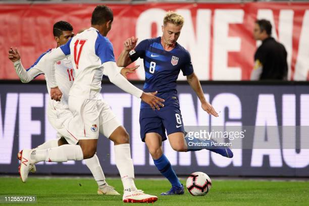 Djordje Mihailovic of United States controls the ball against Luis Canate and Ivan Anderson of Panama during the second half of the international...