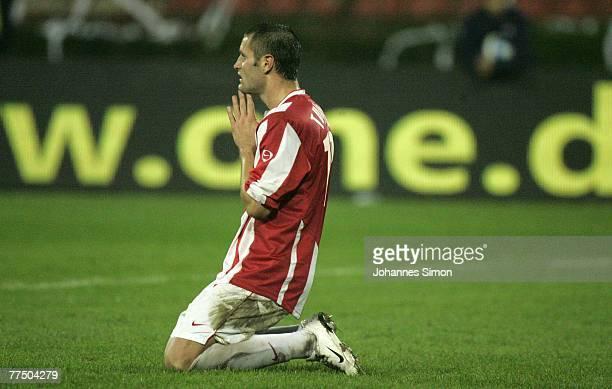 Djordje Tutoric of Belgrade prays after loosing the UEFA Cup group F match between Crvena Zvezda and Bayern Munich at Crvena Zvezda Stadium on...