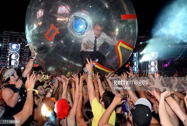 DJ/producer Diplo of Major Lazer surfs the crowd as he performs at the 17th annual Electric Daisy Carnival at Las Vegas Motor Speedway on June 23...