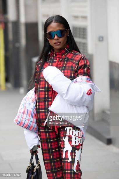 Producer Dren Coleman wears Nicopanda tracksuit during London Fashion Week September 2018 on September 14, 2018 in London, England.