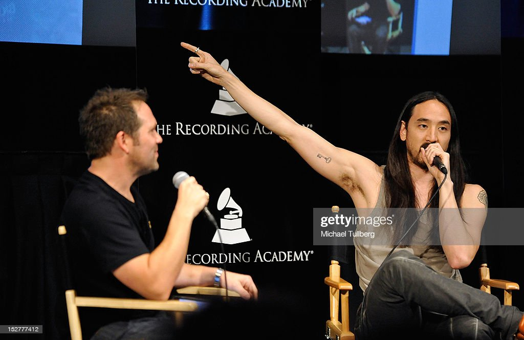 DJ/Producer Steve Aoki (R) gets interviewed arrives at an 'Up Close & Personal with Steve Aoki and Kaskade' Q&A session for GRAMMY U Los Angeles at Los Angeles Film School on September 25, 2012 in Los Angeles, California.